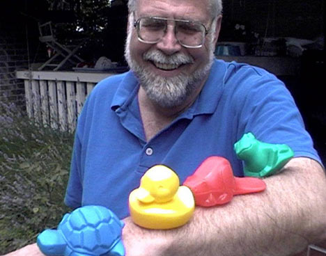 Dr. Curtis Ebbesmeyer, not the author of Moby-Duck, holding the Floatees, a rubber duck, turtle, beaver and frog which were lost at sea