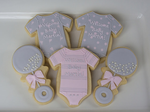 baby girl onesie and rattle cookies