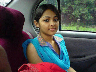 Rich Indian girl posing inside a car.