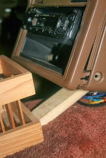 Wood wedging CD player still