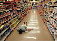 Useless husband face down on floor of supermarket