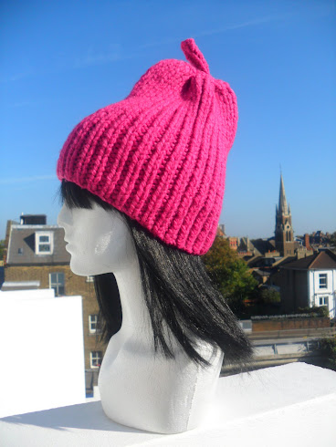 NEW IN .PINK PEAR HAND-KNIT HAT  BY FLORA LYIMO DESIGNER* AVAILABLE IN MANY COLOURS.M:0778 7471024