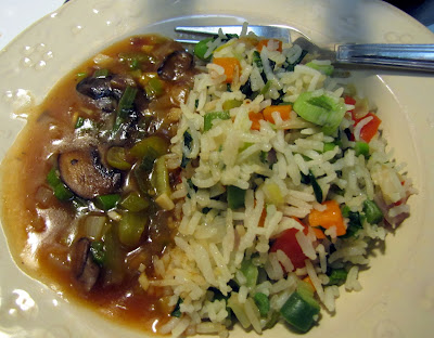 Vegetable fried rice with sweet and sour Mushroom gravy