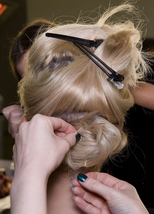 Piled up and pinned hairstyle