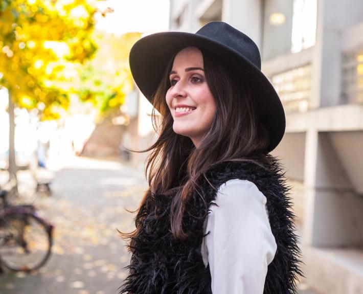 wide brim hat, shaggy faux fur vest