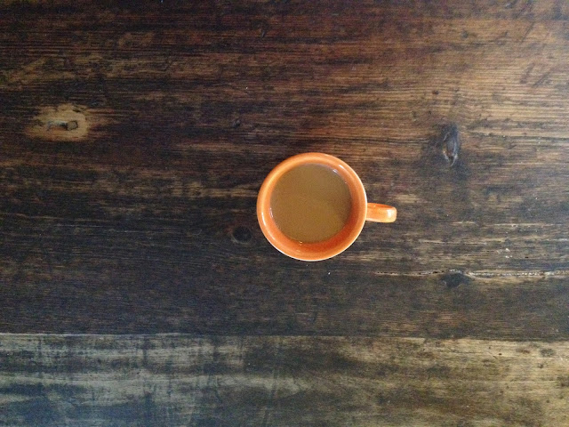 orange cup of coffee