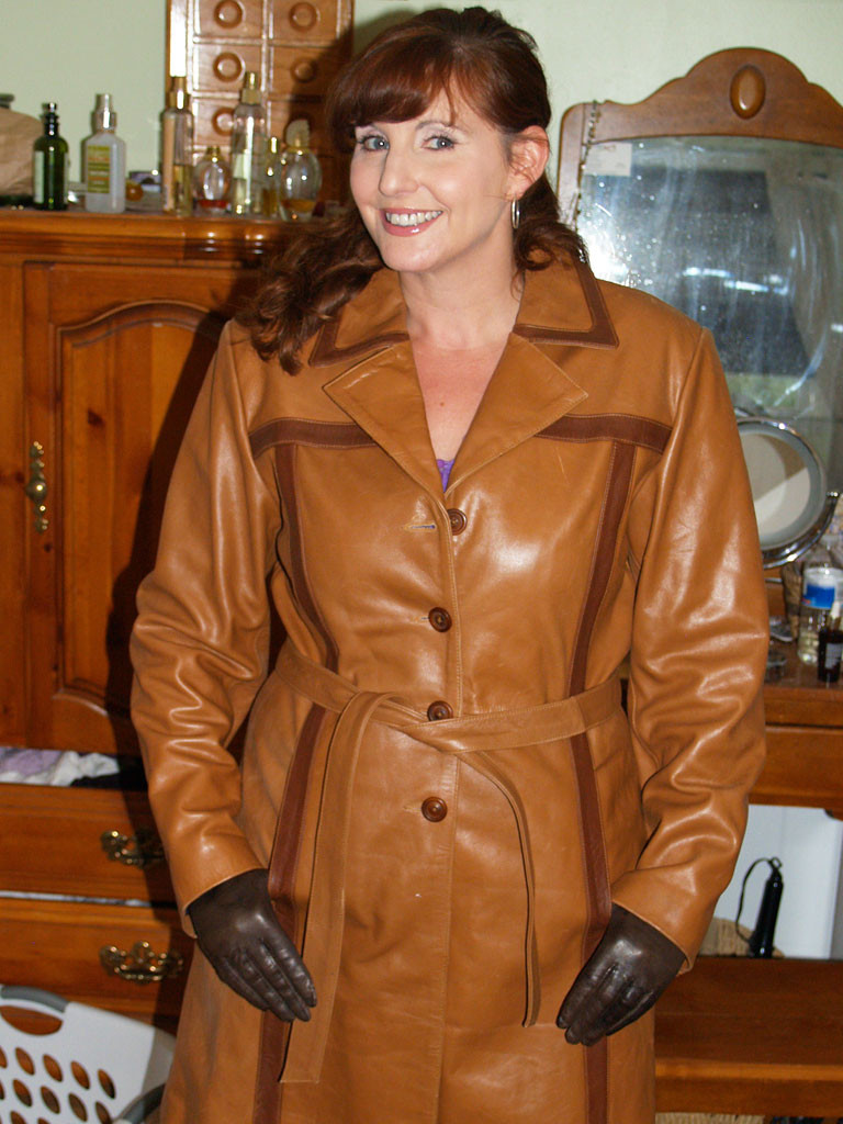 Mature ladies in leather gloves consider