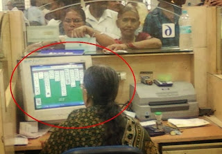 funny picture: bank employee in India sitting gaming at work