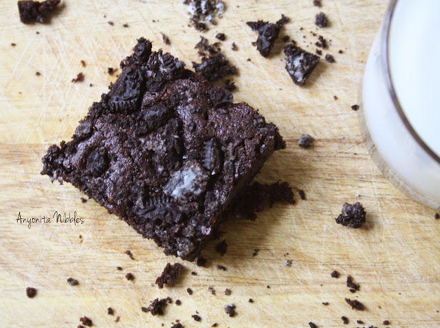 Chocolatey, gooey and delicious Oreo Overload Brownies with a glass of milk