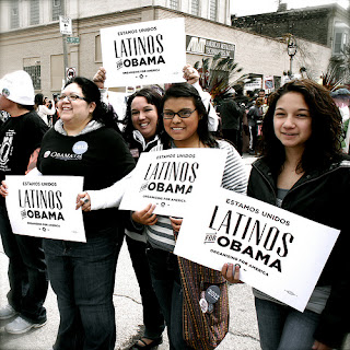 "A line of smiling Latino women holding signs that read ""Latinos for Obama."""