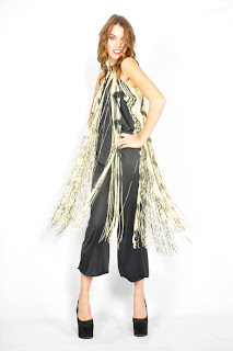Vintage 1970's disco black and white swingy fringe halter jumpsuit.
