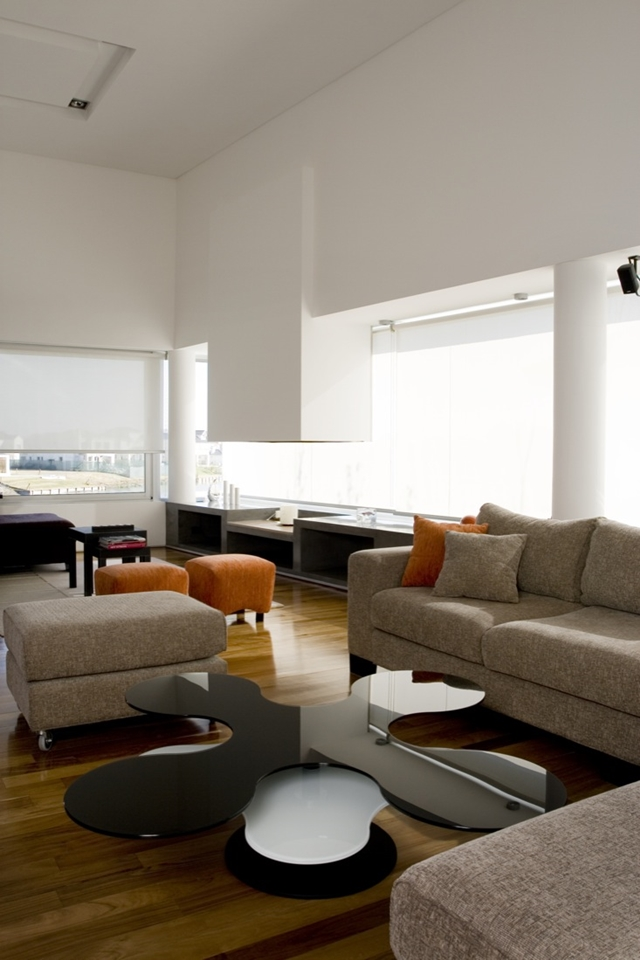 Modern furniture in the living room of Waterfall House