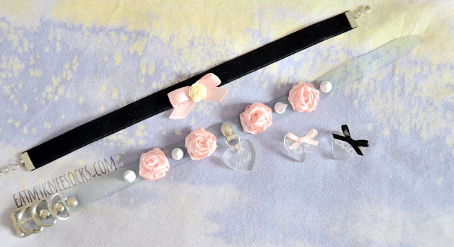 I got four cute accessories from Milkstud, including a velvet ribbon rose choker, clear vinyl choker with pastel pink roses and spikes, and two clear heart pins with Japanese engravings and ribbon accents.