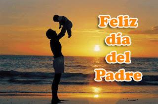 padre sosteniendo a su hijo en brazos
