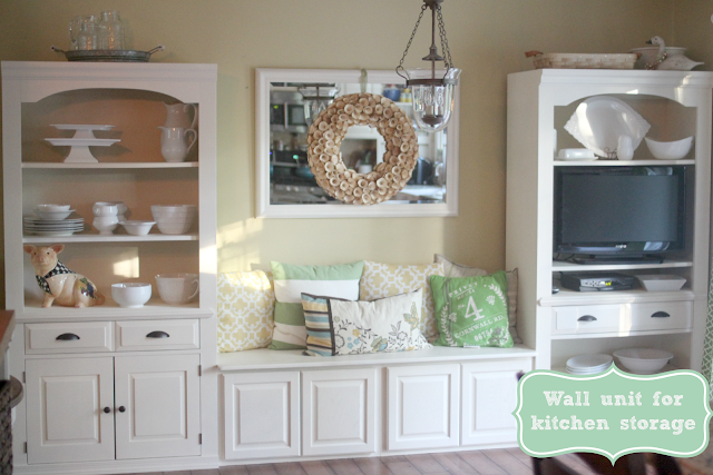Broyhill wall unit painted Rustoleum Antique White repurposed as kitchen storage with upper cabinets to create eating nook via www.goldenboysandme.com