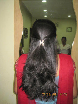 Silky and shiny haired Indian girl.