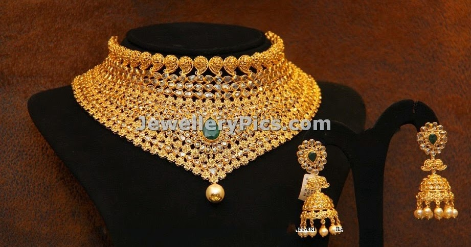 heavy beautifully designed gold choker with single emerald