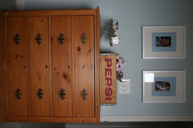 antique dresser, pepsi drink crate, glass cake stand, bla bla stuffed animal, ikea white frames, chevron paper mat, aqua nursery