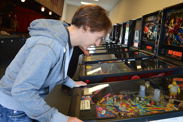 Long Beach, WA. David playing arcade games.