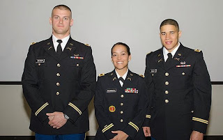 Second Lt. Travis Watson(l) with fellow ROTC commissioned officers.