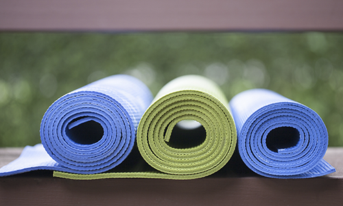 Yoga mats a - Yoga is one way to practice how to lift your mood using exercise.