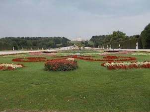 """Lawns of """"SCHOENBRUNN PALACE"""" with """"Gloriette"""" in the distance on the hill."""