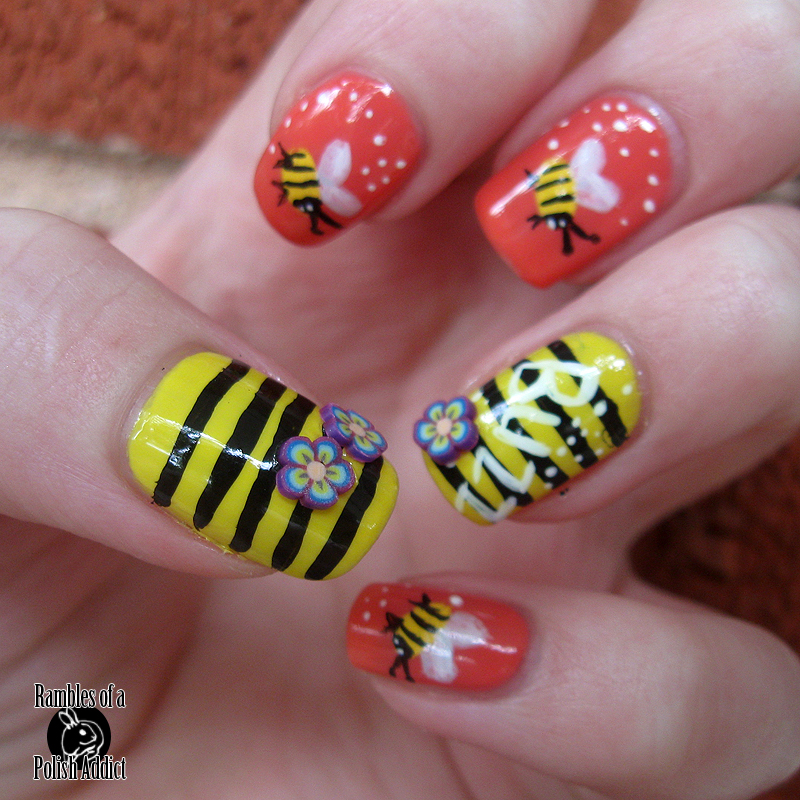 black-and-yellow-and-coral-bumble-bee-nail-art-fimo-cane-flowers