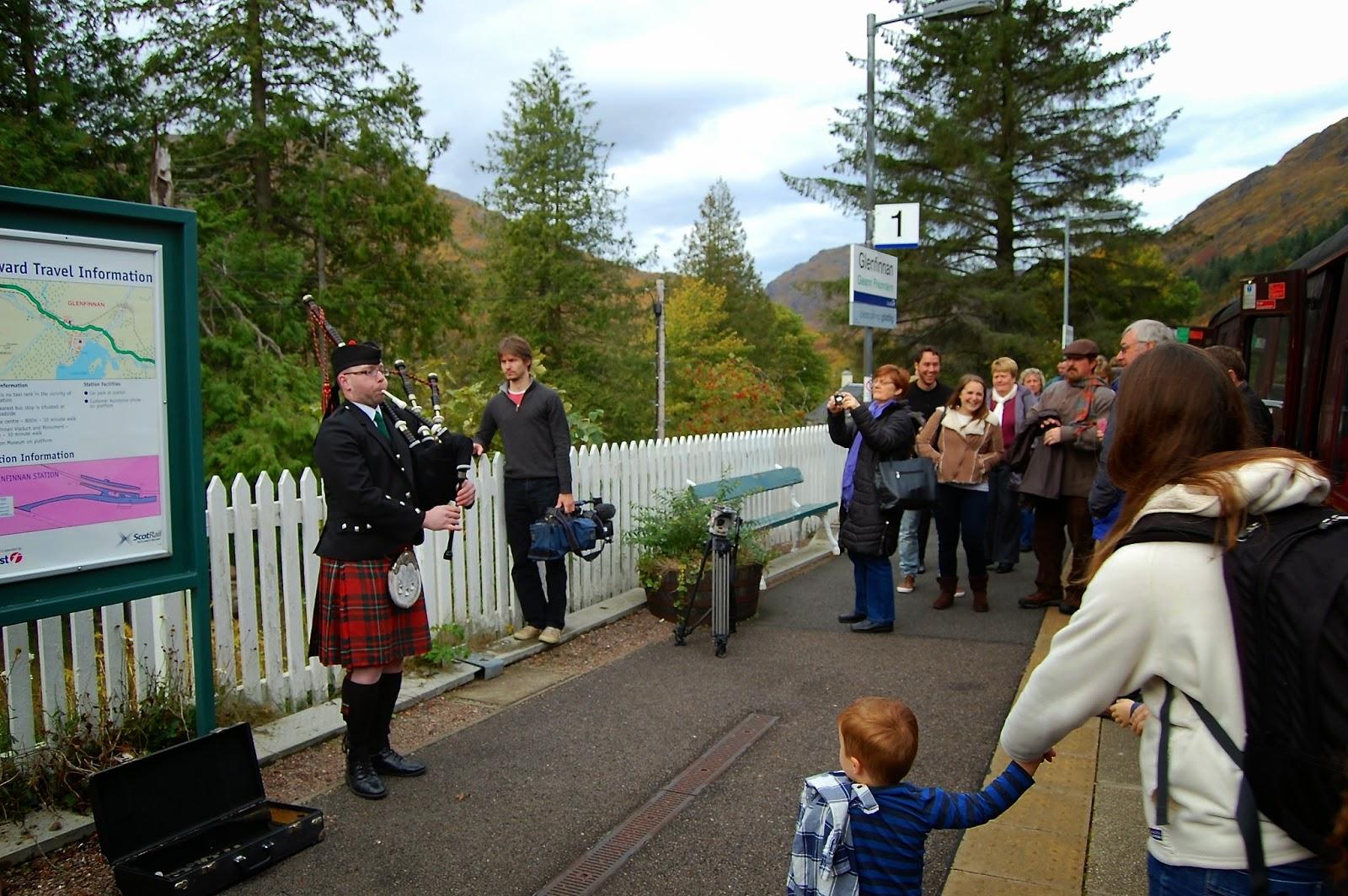 Bagpiper at the Glenfinnan train station
