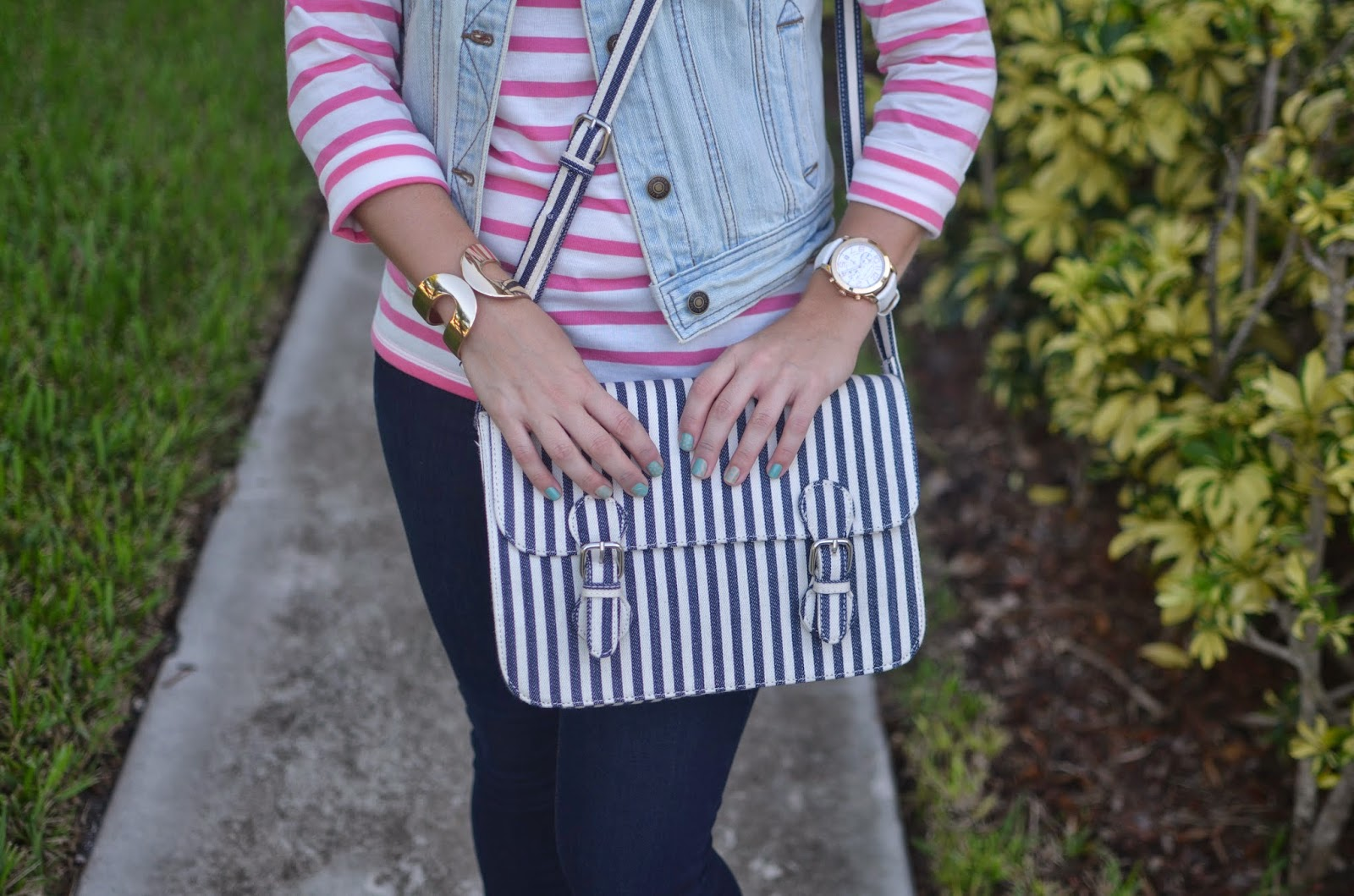 denim vest - striped boat neck top - dark wash jeans - printed slip ons - striped satchel