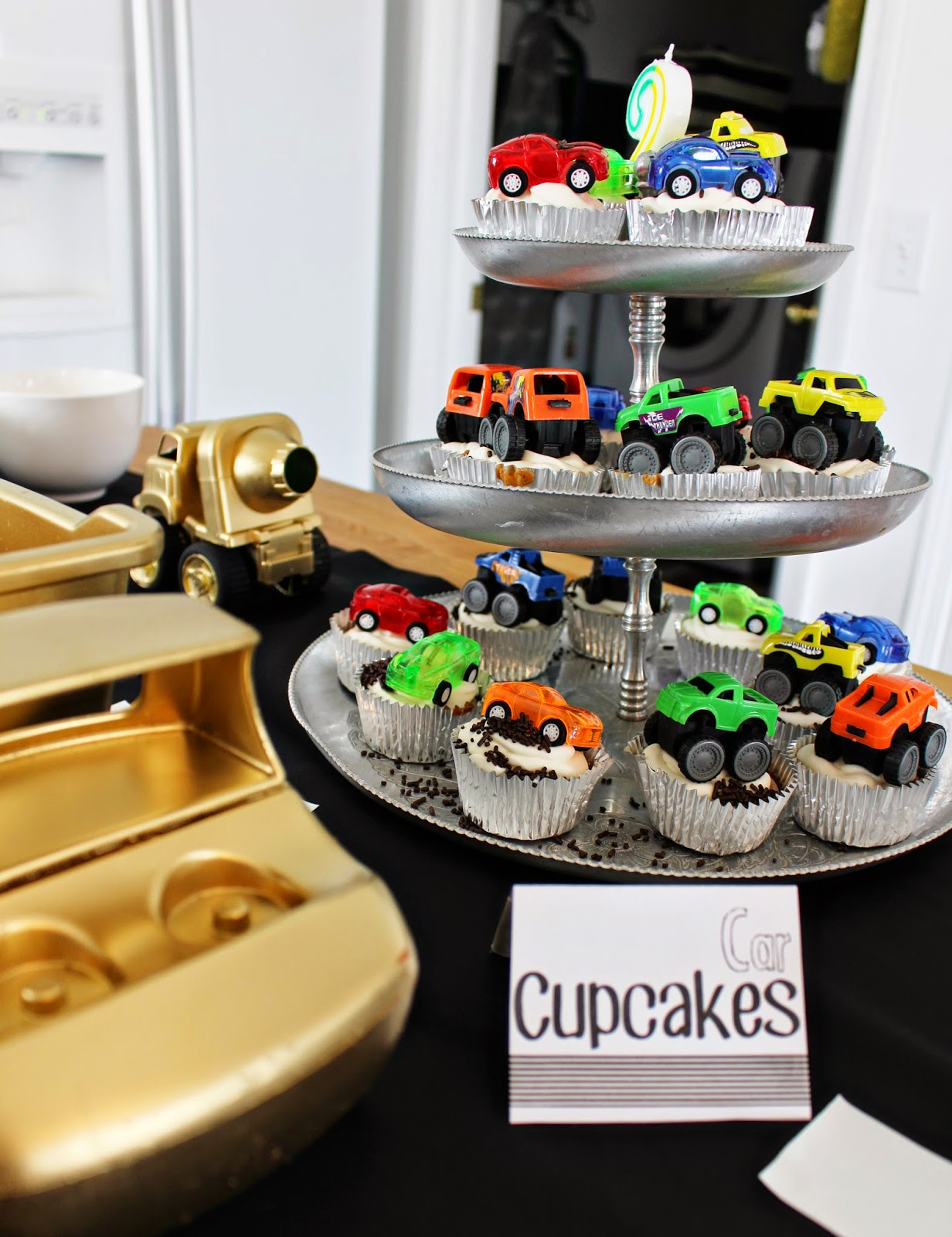 For the cupcake toppers I stumbled upon some mini monster trucks and ...