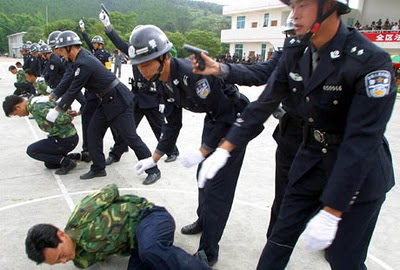 Chinese police officers rehearsing execution procedure