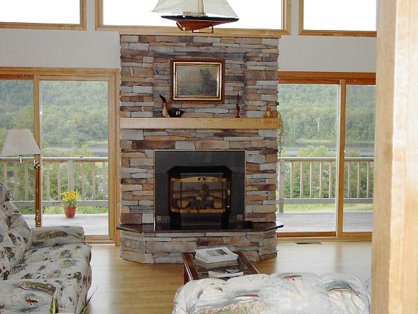 Salas con chimenea ideas para decorar dise ar y mejorar - Chimeneas con piedra ...