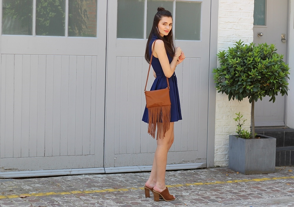 peexo fashion blogger wearing tfnc skater dress with d-ring belt and suede mules and fringe bag in summer