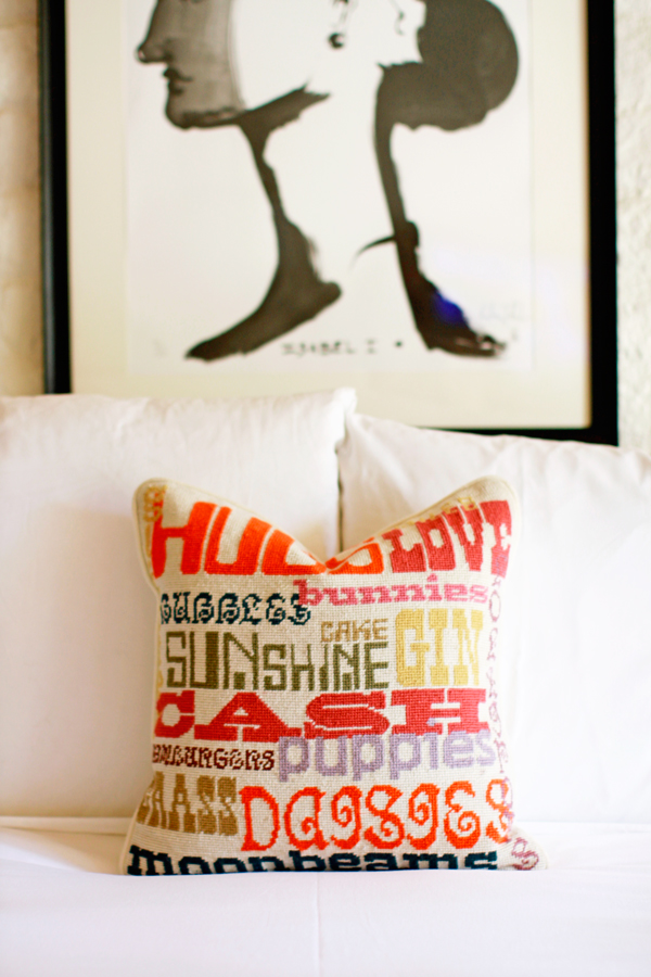Jonathan Adler needlepoint pillow—hugs, sunshine, cake, gin and puppies!
