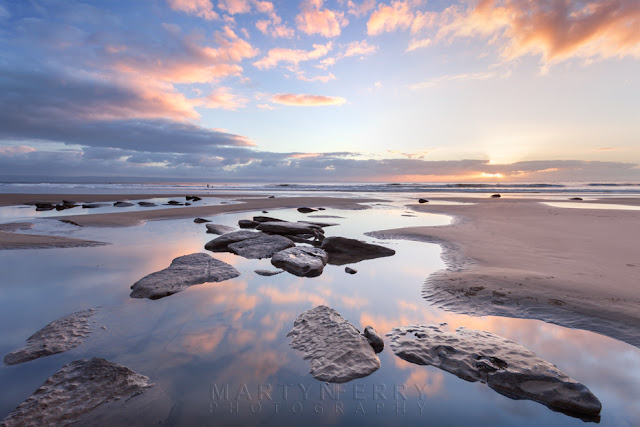 Dunraven Bay sunset with reflected clouds in the foreground by Martyn Ferry Photography