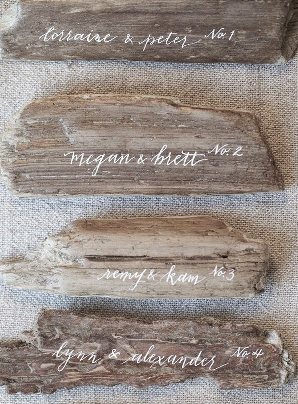 Driftwood escort cards - Beautiful Examples of Hand Lettering in Wedding Signage on HelloBrio.com