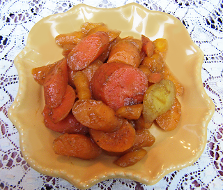 Plated Yellow, Red, and Orange Carrots Sprinkled with Cinnamon