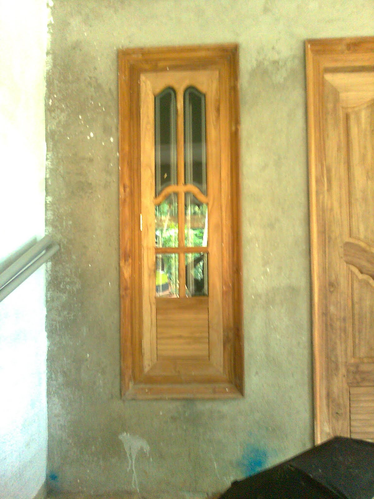 Bavas wood works wooden window doors simple designs for Simple wooden front door designs