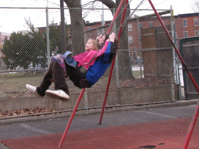 man and girl on swings