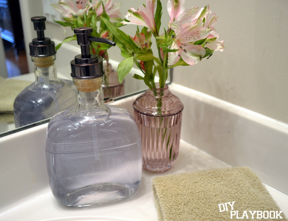 Our finished bourbon bottle soap dispenser looks fantastic in our bathroom!