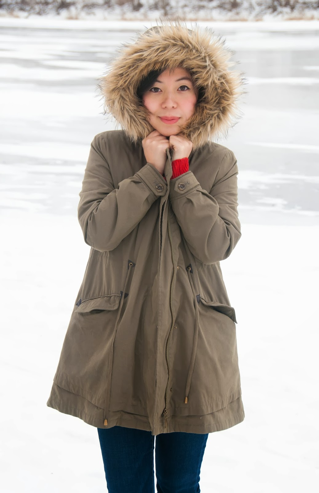 parka army green coat hat beanie infinity scarf red sweater booties jeans grey mittens