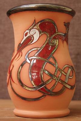terra cotta kitchen utensil holder with Celtic dragon