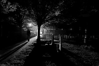 Man walking in dark through a path