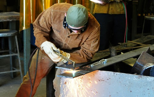 Student learns how to weld