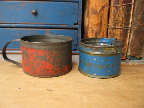 Late 1800s tin cups with their original paint