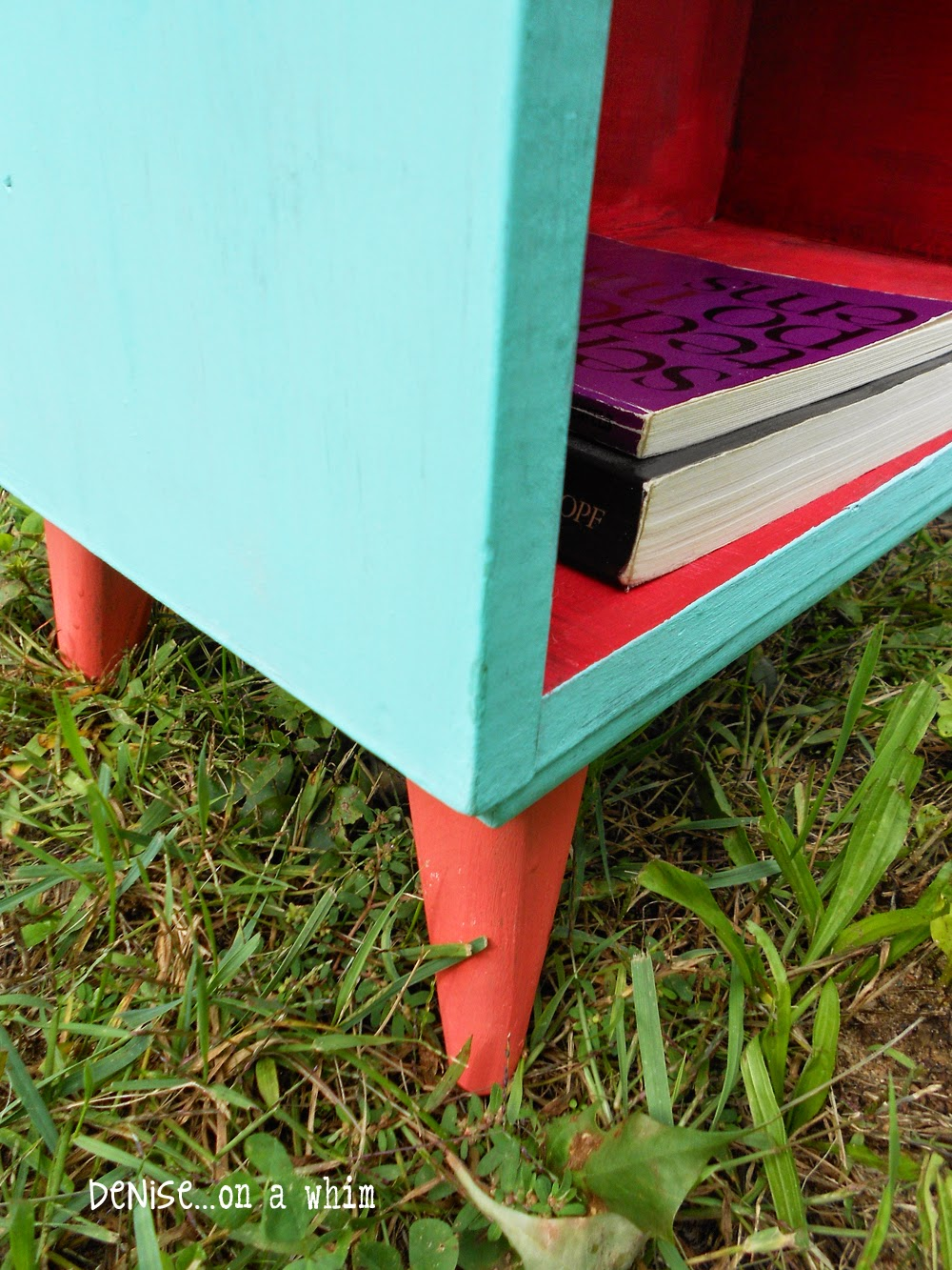 Coral Feet with Turquoise and Red on a Bookcase Makeover from Denise on a Whim