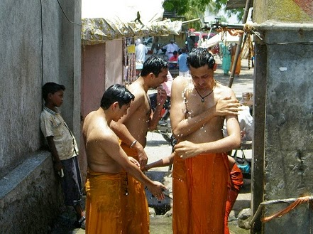 Devotees taking bath before going  to temple