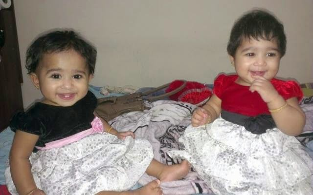 One years old indian twins baby girl wins a BMW car