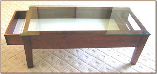 glass top coffee table with display drawer