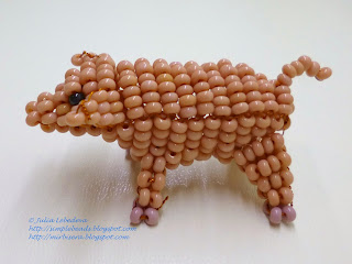 3D pig out of seed beads and wire